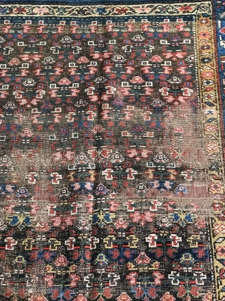 Antique Kurdish runner  rows of offset flowers/shrubs on a brown field (field having oxidized) both ends and edges are secured good soft wool, wool foundation, there are 3 darned repairs (as  ...