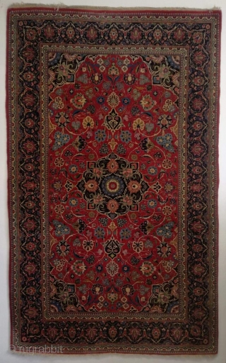 An old natural dyed Iran Kashan in fine and good condition. 215/135 cm.
