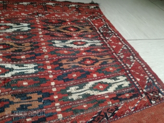 An very old Yomud Chuval with 100/70 cm. A lot of dirt and dust on very good colors. Need a professional collectors wash, it is a collectors piece.