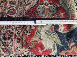 An old fine Kashan carpet with 340/260 cm. Generally in good shape with even high pile but a lot of spot moth demages.