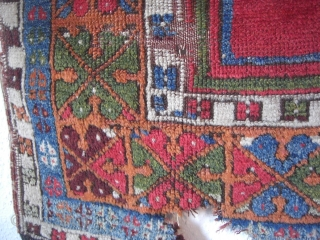 An antique Anatolian prayer rug fragment. All natural dyes. 143 X 93 cm.
