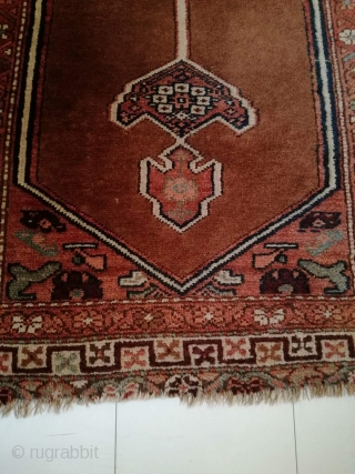An antique camel hair ground NW Persian runner with 430/108 cm in good condition. Two spots repiled. One side with kilim ending, the other open. On wool rug.