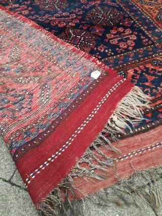 An antique kurdish Iran Kordi rug with 230/125 cm. Very good shape. Wool warps.