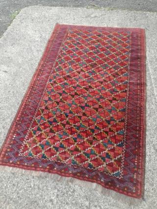 An antique Turkmen rug with 190/115 cm. Good shape with spot worn places.