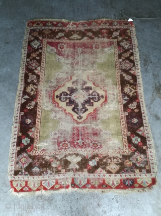 An 1870 Anatolian rug fragment with 160/110 cm.