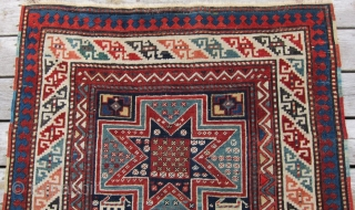 """Late 19th c. Gendje, 3'8"""" x 9'1"""".  A very attractive long rug featuring lovely stars and animals in very good condition."""