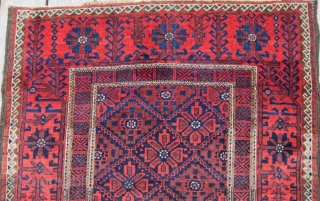 "An attractive example of Baluch weaving from the Khorasan region circa 1900, 3' x 5'8"", featuring a flower and vine border surrounding a central diamond lattice field. Spacious open treatment of top  ..."