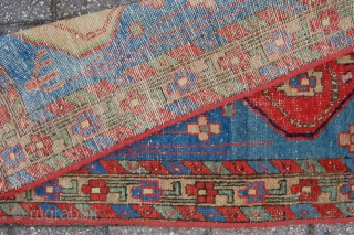 "Antique North West Persian Heriz area village rug  141 x 76 cm (4ft 8"" x 2ft 6"") Last quarter 19th century. All natural dyes. Condition: used, good evenly low pile with  ..."