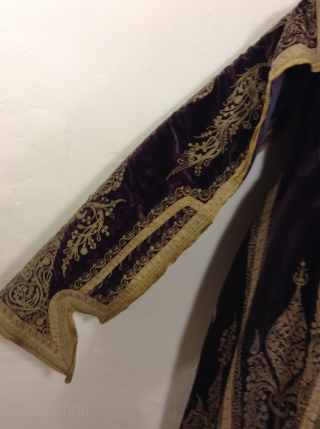 Full length Turkish woman's robe with open sleeves. Beautiful deep purple silk velvet with gold metal thread using couching style decoration.  I am guessing that it was made before the First  ...