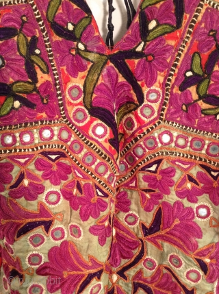 This is a Choli which is a backless blouse from India originally worn with a Sari.  This one is in perfect condition with beautiful