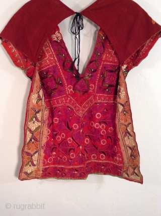 This is a Choli which is a backless blouse from India originally worn with a Sari.  This one is in perfect condition with beautiful embroidery and is aesthetically very pleasing.  It  ...