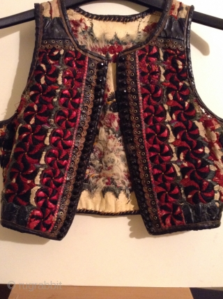 I believe this is an Hungarian or Transylvanian vest, but I am not positive.  It is embroidered on leather and  still has some of the fur lining.