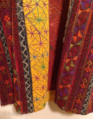 This is a very finely embroidered Arab Woman's dress from the area called the West Bank of Israel. The design and quality of the embroidery makes it possible to identify what town  ...