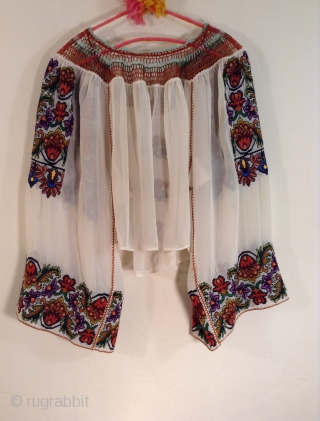 This is a very beautiful and rare Roumanian blouse made between the two Worild Wars in one specific village in Roumania. The embroidery is extremely tiny and dense with black yarn used to  ...