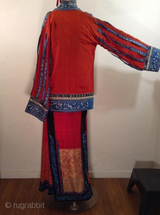 This is a very unusual Chinese suit  mixing a traditional Chinese style pleated and embroidered silk skirt with a more Western style  jacket..  It was probably custom made for an  ...