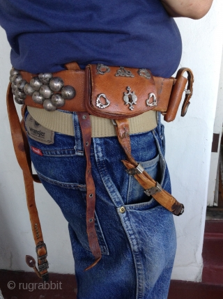 Afghanistan horseman's leather belt.  Very unusual. Beautifully decorated with silver pieces.  There are 4 pouches, 2 for money and 2 for knives or other utensils.  The buckle Is silver  ...