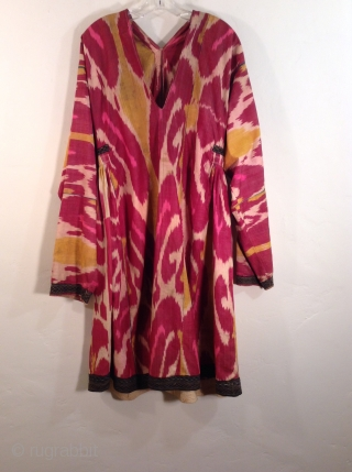 This is an Uzbek ikat silk dress with very traditional colors.  It is in very good condition and would fit a large woman.