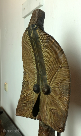 Kota Gabon,  mid 20th century.  Guard at the tomb of a Chief.   Copper over wood, this conserved the image. hight: 56 Cm.-with stand: 65 Cm.