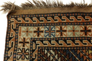Gendje, Caucasus.  207 x 110 Cm. 7 ft. x 3.6 ft.  Wool on wool.  Warp thick brownish wool.   Typical pattern for Gendje.  Old colors, full pile. Gool condition.  Running dog borders flanking  ...