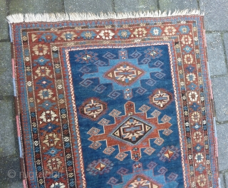 "Caucasian Shirvan ca. 1900, 184  x 117 cm., 6' x 3'10"". Knotted on woolen ground and with all natural dyes. With lower browns and some wear in two places ( see  ..."