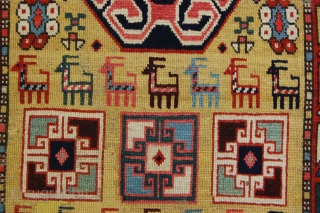 """3'2"""" x 7'3"""" Nw. Persian/S Caucasian rug. Good graphic design, nice color. Worn flat in areas with about 5""""x5"""" of the yellow ground re-knotted mid field, original ends and sides. Pretty &  ..."""