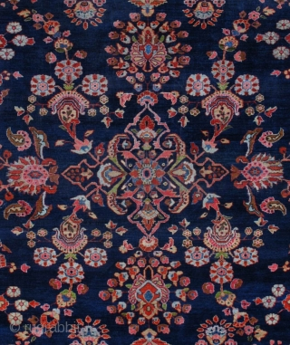 "#7050 Mahajaran Sarouk Antique Persian Rug This circa 1910 Mahajaran Sarouk antique Persian Oriental Rug measures 9'1″ X 11'10"". It has the so-called empty design motif with a floral medallion.  It  ..."
