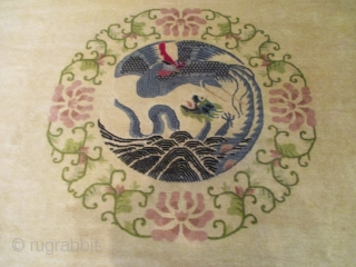 """7877 Peking Chinese carpet This third quarter 19th century Peking Chinese rug measures 9'1"""" X 11''10"""" (277 x 363 cm). It has an old ivory colored field with a central medallion in the  ..."""
