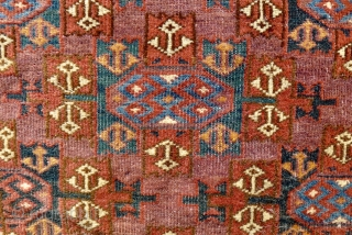 Yomut (wedding?) rug , 90 x 130 cm. with Kepse Gol design. 19 th. Century. Nice old bottle green and mid-blue colours. In good condition, slightly reduced at both ends.