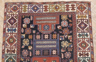 "Shirvan Rug, Shemakha district, Maraza village. 185 x 114 cm. ( 6ft x 3.7ft) around 1910.  The design with two opposing ""Saphs""  with a central squarish medallion on a dark  ..."