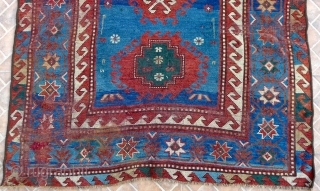 Bordjalou Kazak 215 x 112 cm (7.05ft x 3.7ft) with pre -1900 liveliness. The design with hooked diamonds and medallions on an abrashed blue ground. The field with animals, combs, herding sticks  ...