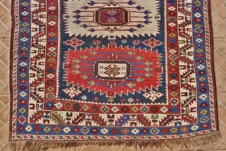A Sunburst Zeiwa Kuba rug, also known as Alikhanly Kuba, 155 x 125 cm (5.1ft x 4.1ft) circa 1900. The design with three large sunburst medallions. These fine Kuba rugs originated from  ...