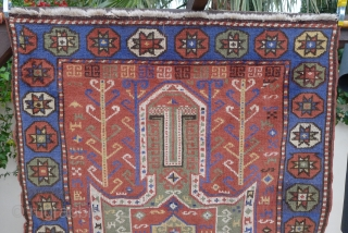 Sewan Kazak, Bordjalou region, 180 x 130cm. (5.9ft x 4.25ft) ca. 1900. The design with a large  mint-green cruciform medallion on a brick-red ground. The main border with a row of  ...