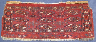 """Very rarely are diminutive Tekke Mafrashes with decorated elems found, very finely woven with good pile and beautiful natural colors, 19th. century, 27"""" X 11""""[69 X 29cm]"""