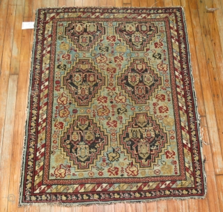 Antique Chila Shirvan with a sky blue field.  Sides and ends need some attention.  3'5''x4'2''