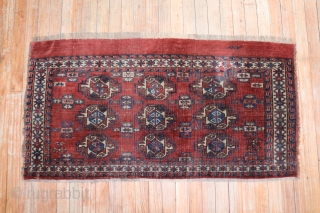 Antique Turkoman with an inscription.  Size is 2'x4'.  Has a repair.