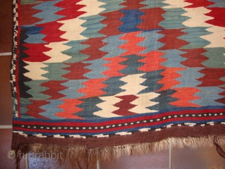 A Veramin kilim, Circa 1900, Very nice colours (natural), Very fine quality, Some very professional repairs, Sides and ends original, Good condition, 320 x 165 cm.
