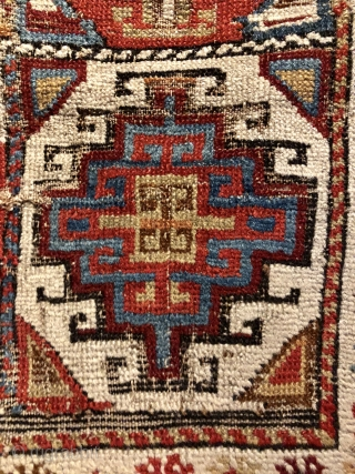 Early Caucasian (140x95 cms)Small perfectly worn out complete rug it also has brindled (camel?) warps and a very interesting Memling gul.