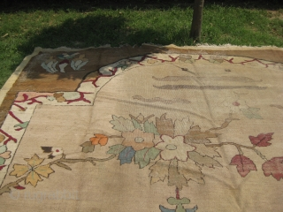 An old Art Deco rug needs repair measuring 15.2 x 11.8 feet.