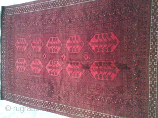 Baluch rug minor repaired area measuring 210 x 140 cm.. Mid 20th century