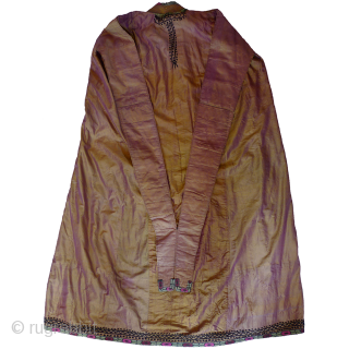 Woman's Paranja. Uzbekistan, c.2nd quarter 20th century. This elegant paranja is made of silk taffeta. This lustrous fabric appears mauve and bronze depending on the light. Fully lined with printed cotton in  ...
