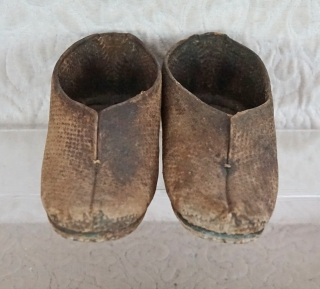 This old pair of boys well worn field shoes are from Southern China...They are stiff with age and exposure to water and mud...8 inches long