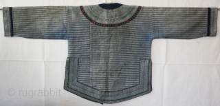 EMT #150   This was the traditional jacket used by girls of the Yi Chinese ethnic Minority. Girls wore this style until they were married. This garment is small and was  ...