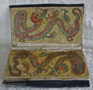 EMT159    Dong Ethnic Minority textile wallet   This wallet would have been used to keep sewing supplies Each page is made from heavy hand paper, hand painted decoration and  ...