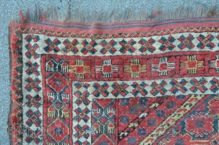 Antique Beshir mounted on cloth, 240 x 150 cm, lots of home made old repairs, corroded brown. Rare design with beautyful colors. First half 19th.