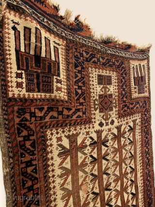 Rare Antique Baluch Prayer Rug. Circa Early. Powerful indigo S dragons inside hand panels and a fine trefoil border frame three and a half tree totems on rare ivory ground field. Note:  ...