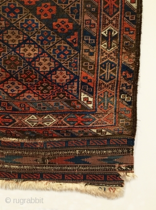 Antique Timuri Baluch Rug.  Last Quarter 19th Century.  Diagonal rows of stepped cross motifs form diamond pattern on field.  Outlined by three color rich geometrically styled borders.  Good  ...