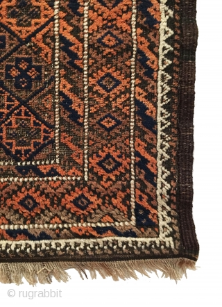 Antique Baluch Rug. Late 19th Century. Saturated colors. Soft, lustrous wool. It features an all-over diagonal diamond lattice field design enclosing crosses with a central ivory focal point. Slight brown corrosion enhances  ...