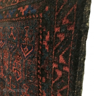 Antique Timuri Baluch Bag Face. 1st Quarter 20th Century. Hexagonal medallion enclose tree motifs floating on dark green.  Original selvage. Soft lustrous wool. 5 colors. 2'1 x 2'1. Carefully hand washed.