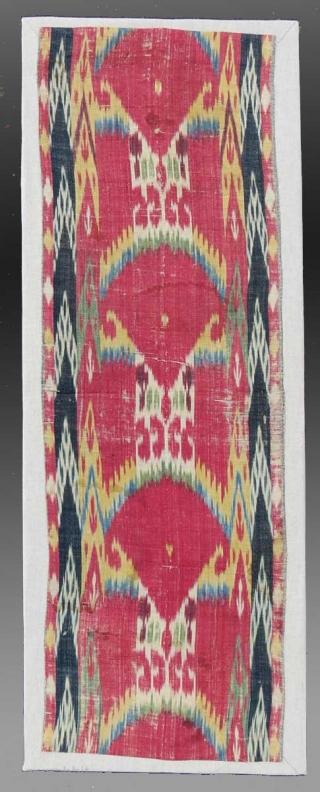 """Ikat Panel, (mounted fragment), Central Asia, 19th Century, 11"""" x 2 9""""  An extremely attractive example of textile art, with some fabulous design elements.  The borders are quite nice and handled in  ..."""