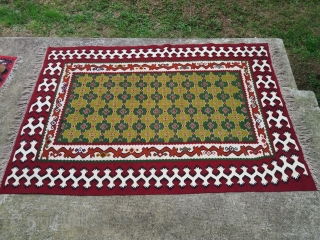 An interesting Pirot sarkoy kilim  with  kostenica  motif in the borders, measuring about 1.5x2m